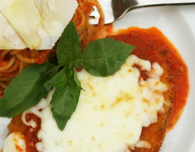 Chicken Parmesan Garnished with Pasta